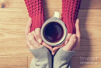 Photograph - A Couple In Love Warming Hands With A Hot Mug Of Tea by Michal Bednarek