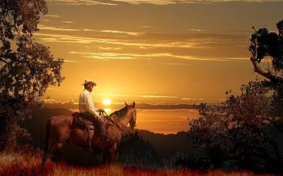 A Cowboy Riding On His Horse Into A Yellow Sunset. Art Print by Peter Nowell