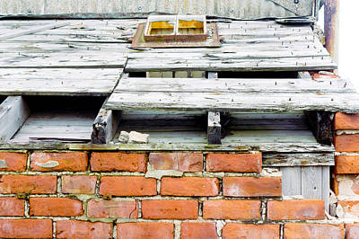 A Damaged Roof Art Print by Tom Gowanlock