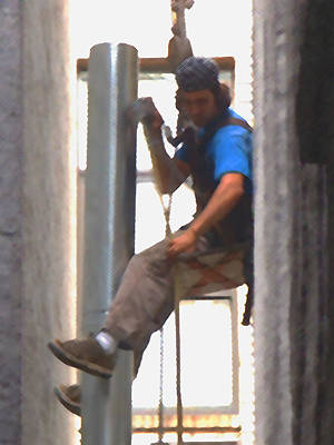 Photograph - A Dangling Pipefitter by Stan  Magnan