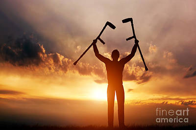 A Disabled Man Raising His Crutches At Sunset Art Print by Michal Bednarek