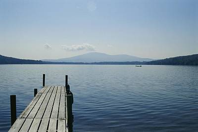 Etc. Photograph - A Dock Juts Into The by Stacy Gold