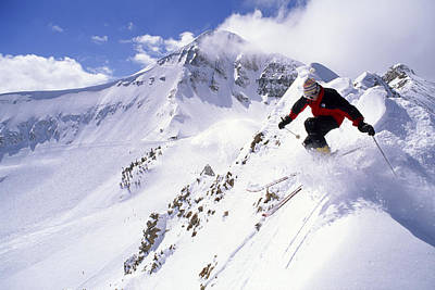 Natural Forces Photograph - A Downhill Skier Launching by Gordon Wiltsie