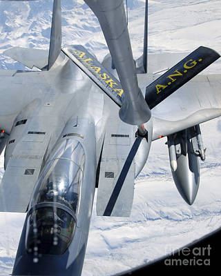 Stratotanker Photograph - A F-15 Eagle Refuels Behind A Kc-135 by Stocktrek Images
