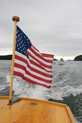 A Flag Waves On The Stern Of A Maine Art Print by Heather Perry