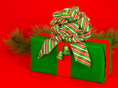 A Gift  In Green With Red And Green Bow       Ribbon, Is Topped With  Original