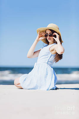 Photograph - A Girl In Straw Hat Sitting On A Beach By The Sea by Michal Bednarek