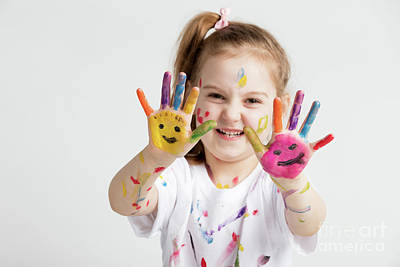Photograph - A Girl Showing Her Colorful Painted Hands by Michal Bednarek