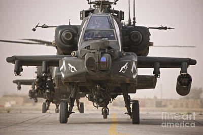A Group Of Ah-64d Apache Helicopters Art Print by Terry Moore