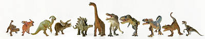 Animals Digital Art - A Group of Eleven Dinosaurs in a Row by Derrick Neill
