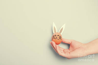 Photograph - A Hand Holding Little Easter Bunny With Paper Ears by Michal Bednarek