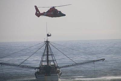 Photograph - A Helicopter Hovers Close To Capt Nathan Trawler The Coast Guard Medevaced The Captain by Paul Fearn