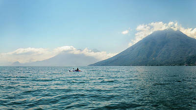 Photograph - A Kayaker In The Blue Waters Of Lake Atitlan, Guatemala by Daniela Constantinescu