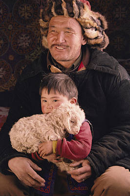 A Kazakh Eagle Hunter And His Son Art Print by David Edwards