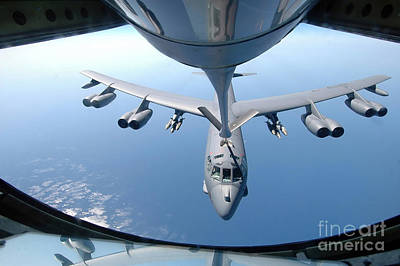 Stratotanker Photograph - A Kc-135 Stratotanker Refuels A B-52 by Stocktrek Images