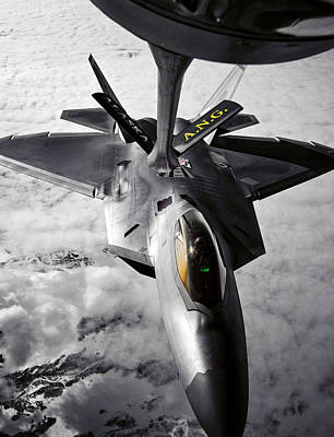 Stratotanker Photograph - A Kc-135 Stratotanker Refuels A F-22 by Stocktrek Images