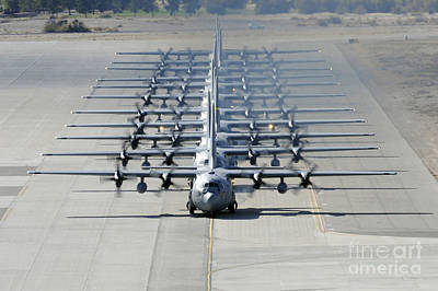 A Line Of C-130 Hercules Taxi At Nellis Print by Stocktrek Images