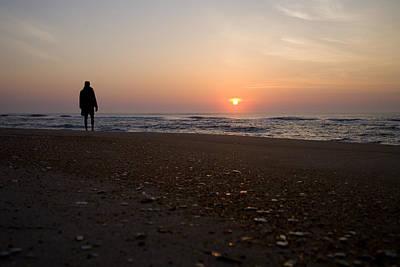 A Lone Figure Enjoys The Ocean Sunrise Art Print by Stephen St. John