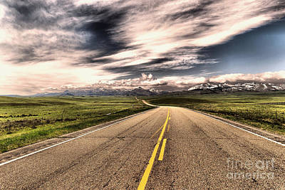 Birds Rights Managed Images - A long road to the mountains Royalty-Free Image by Jeff Swan