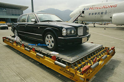 Transportation Of Goods Photograph - A Luxury Bentley Unloaded From An by Justin Guariglia