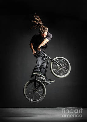 Photograph - A Man Doing An Extreme Stunt On His Bmx Bicycle. by Michal Bednarek