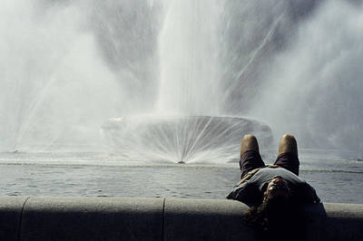 A Man Relaxes At A Fountain Art Print by Stacy Gold