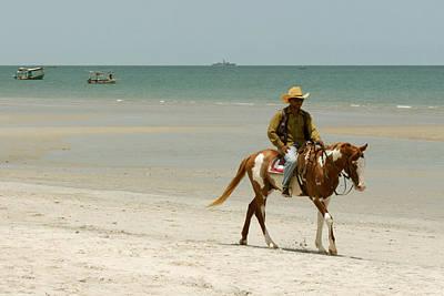 Horse Photograph - A Man Rides A Horse  by Palin Lertpoonwasin