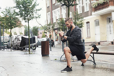 Photograph - A Man Working Out On A Street by Michal Bednarek