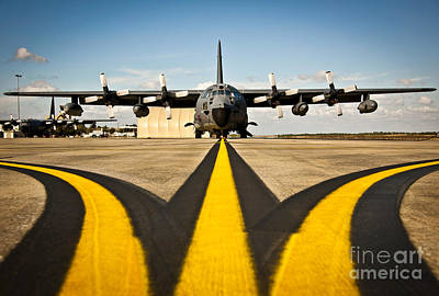 A Mc-130e Combat Talon I Awaits Art Print by Stocktrek Images