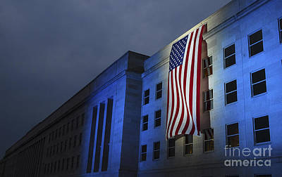 A Memorial Flag Is Illuminated On The Print by Stocktrek Images
