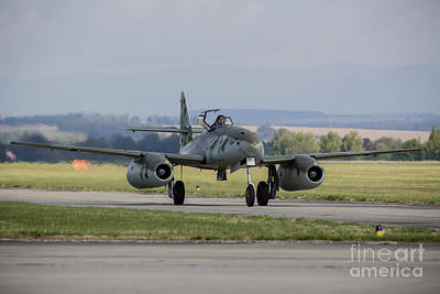 Transportation Royalty-Free and Rights-Managed Images - A Messerschmitt Me-262 Replica Taxiing by Timm Ziegenthaler