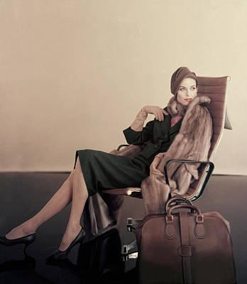 Eames Chair Wall Art - Photograph - A Model In An Eames Chair by Karen Radkai