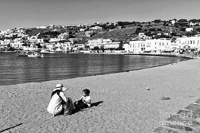 Photograph - A Mother And Child At Mykonos Mono by John Rizzuto