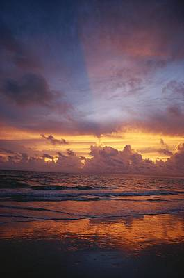 Cosmic And Atmospheric Phenomena Photograph - A Multi-hued Sunset Over Marco Island by Raul Touzon