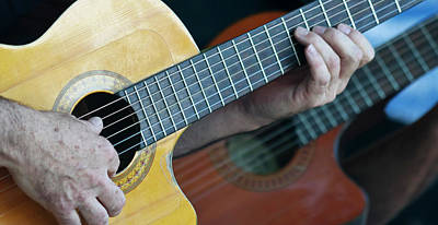 Musicians Royalty Free Images - A Musician Plays a Classical Cutaway Guitar Royalty-Free Image by Derrick Neill