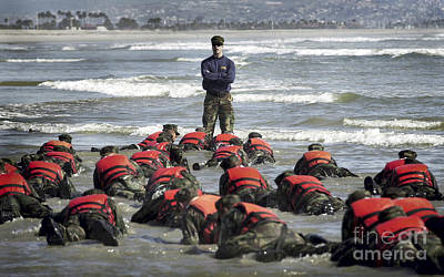 Navy Seals Photograph - A Navy Seal Instructor Assists Students by Stocktrek Images