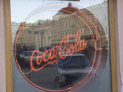 A Neon Coca Cola Sign Is Displayed Art Print