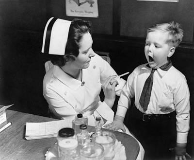 A Nurse Examining The Teeth Of A Boy Art Print