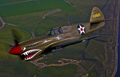 Us Army Fighters Photograph - A P-40e Warhawk In Flight by Scott Germain