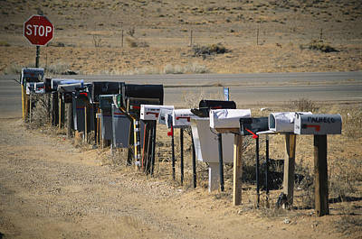 Traffic Sign Photograph - A Parade Of Mailboxes On The Outskirts by Stephen St. John