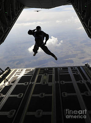 A Paratrooper Salutes As He Jumps Art Print
