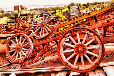 Photograph - A Pile Of Three Old Wheels by Jeff Swan