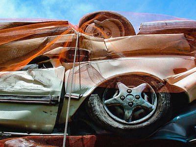Photograph - A Pile Of Tied And Netted Autos by Stan  Magnan