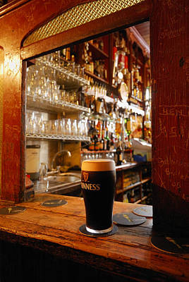 Local Food Photograph - A Pint Of Dark Beer Sits In A Pub by Jim Richardson