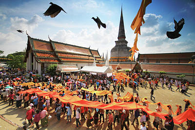 Photograph - A Procession Of Buddhists Bearing A Long Cloth Thailand by Kosin Sukhum