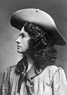 Black Curly Hair Photograph - A Profile Portrait Of Sharpshooter Annie Oakley by American School