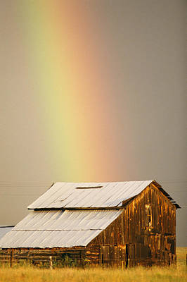 Metal Roof Photograph - A Rainbow Arches From The Sky Onto by Michael S. Lewis