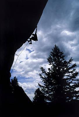 A Rock Climber Ascends A Steep Route Art Print by Bill Hatcher