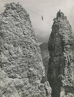 Photograph - A Rock Climber Bridges A Gap by No Credit Given