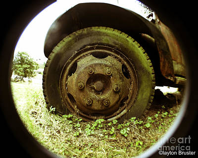 Photograph - A Rolling Tire Gathers No Moss by Clayton Bruster